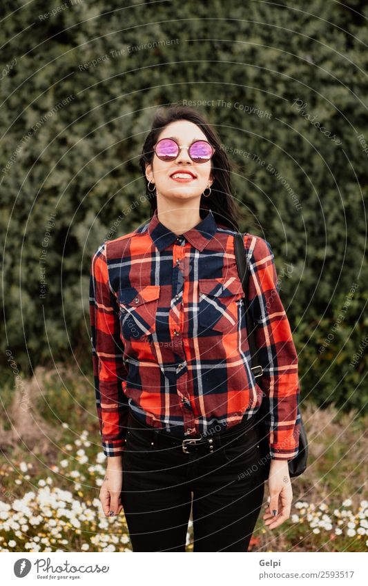 Pretty brunette girl Style Happy Beautiful Face Wellness Human being Woman Adults Lips Nature Flower Park Fashion Jacket Leather Sunglasses Brunette Smiling