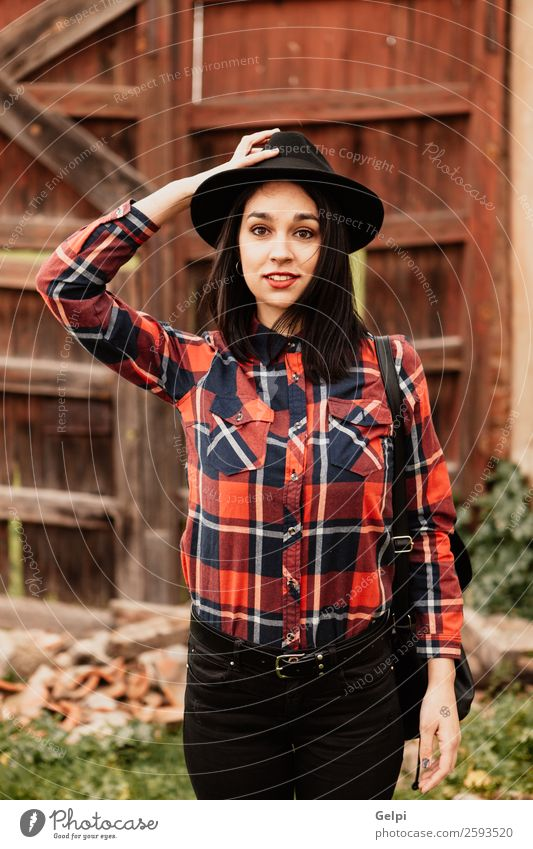 Brunette girl Lifestyle Style Happy Beautiful Face Human being Woman Adults Lips Fashion Clothing Shirt Wood Smiling Cool (slang) Hip & trendy Modern Cute Red