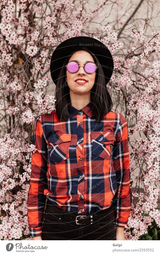 Pretty brunette girl Style Happy Beautiful Face Garden Human being Woman Adults Nature Tree Flower Blossom Park Fashion Sunglasses Hat Brunette Smiling