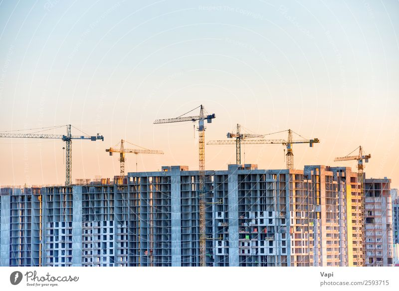 Construction site with building cranes Sky Blue Town White Sun Red House (Residential Structure) Black Architecture Yellow Wall (building) Building Business