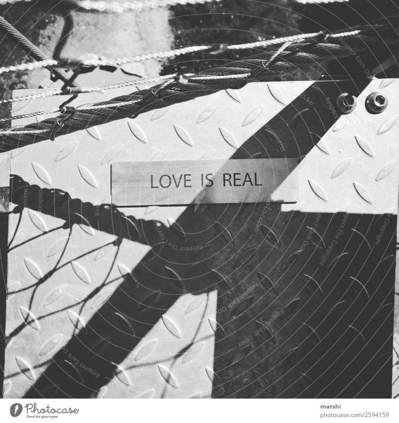 LOVE IS REAL Stairs Tourist Attraction Landmark Sign Characters Signs and labeling Signage Warning sign Emotions Moody Love Infatuation Authentic Metal Eternity