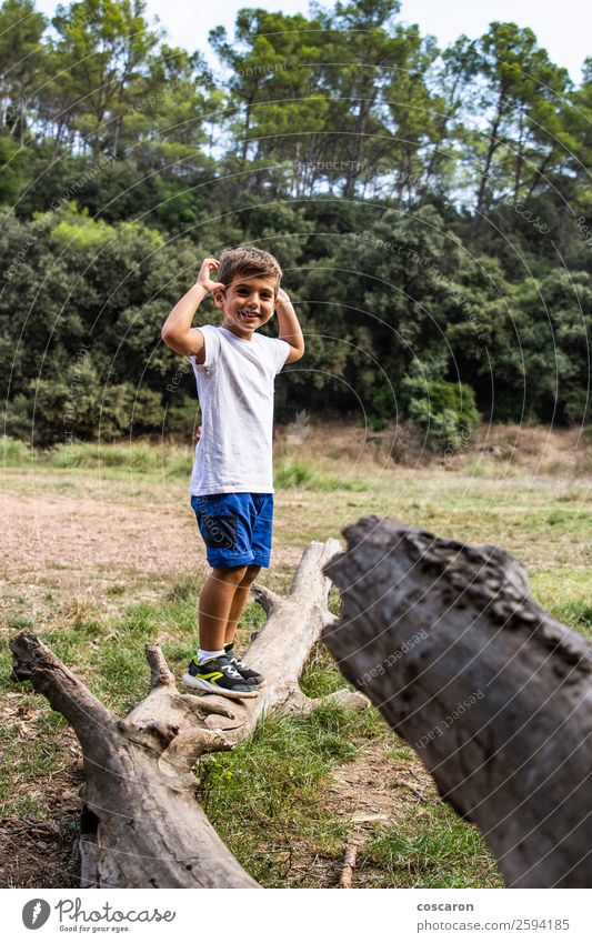 Cute child in the woods playing alone Lifestyle Joy Happy Beautiful Face Playing Summer Garden Child Human being Toddler Boy (child) Infancy 1 3 - 8 years