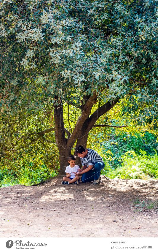 Little boy and his grandma seated under a huge tree Woman Child Human being Nature Summer Beautiful Green White Landscape Tree Joy Forest Lifestyle Adults
