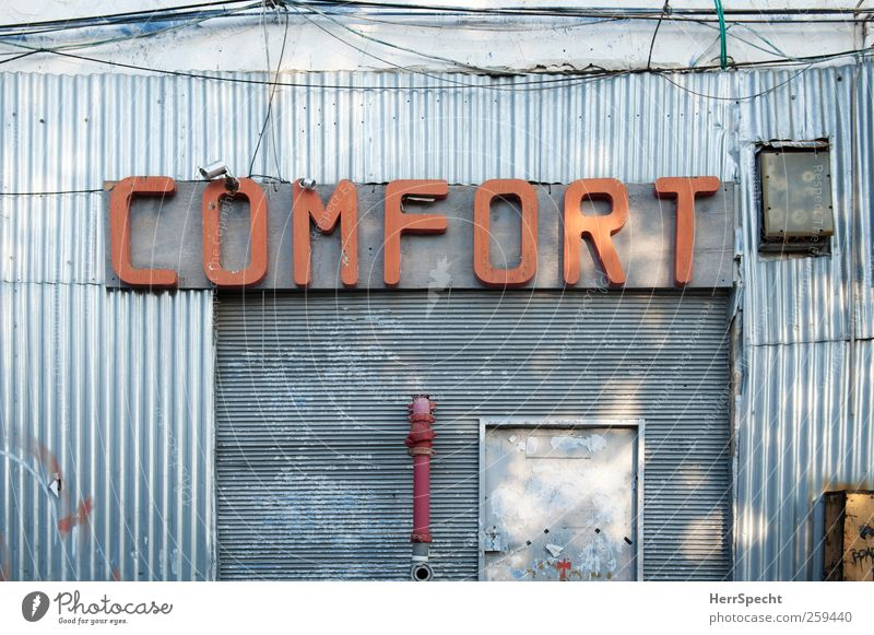 City Red Building Metal Facade Gloomy Signs and labeling Characters Trashy Silver Comfortable Israel Disagreement Commercial building Industrial zone