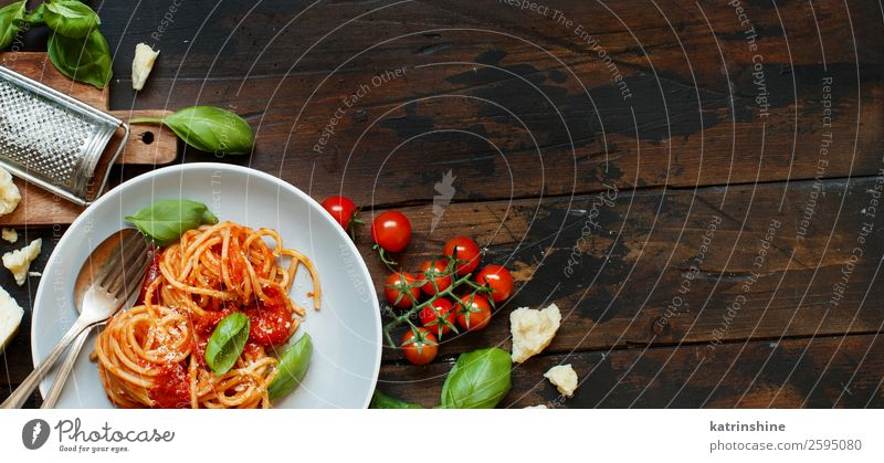 Spaghetti pasta with tomato sauce, basil and cheese Cheese Vegetable Herbs and spices Nutrition Lunch Dinner Vegetarian diet Plate Fork Spoon Restaurant Leaf