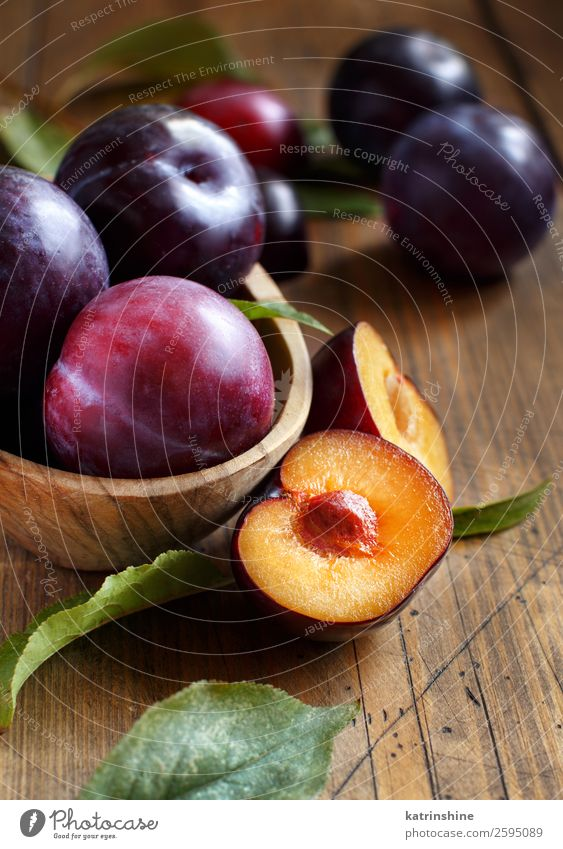 Fresh plums with leaves Fruit Nutrition Vegetarian diet Diet Bowl Summer Table Autumn Leaf Wood Juicy Brown Plum Purple Raw Mature agriculture sweet vitamins