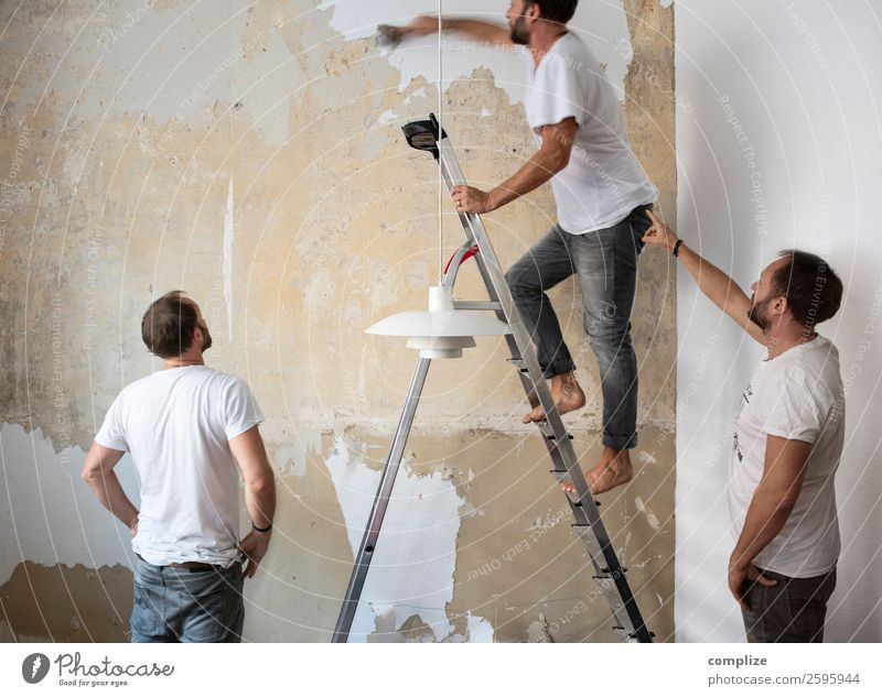 Human being Interior design Wall (building) Living or residing Flat (apartment) Decoration Masculine Moving (to change residence) Facial hair Craft (trade)