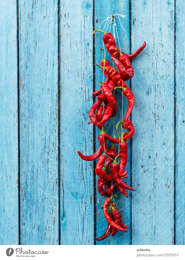 red raw ripe hot chili peppers Vegetable Herbs and spices Rope Wood Eating Fresh Hot Natural Blue Red Colour Hanging food Ingredients Spicy seasoning paprika