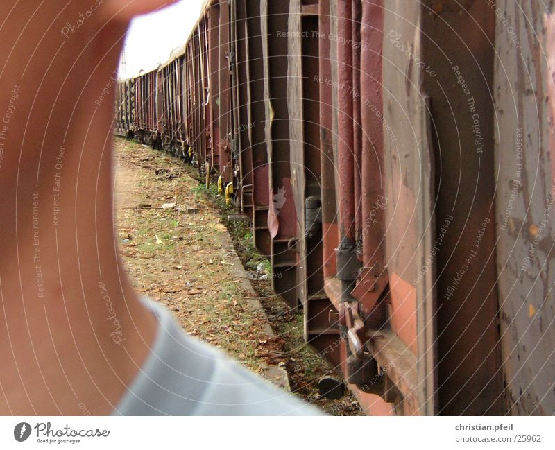 Man Red Face Railroad Near Rust Train station Shoulder Half Goods Freight station