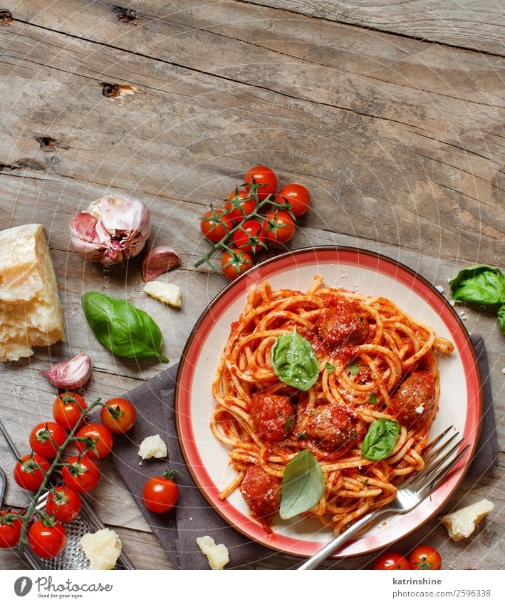 Pasta with tomato sauce and meatballs Meat Cheese Herbs and spices Lunch Dinner Plate Bowl Fork Table Dark Fresh Green Red Black Tradition pasta Basil Spaghetti