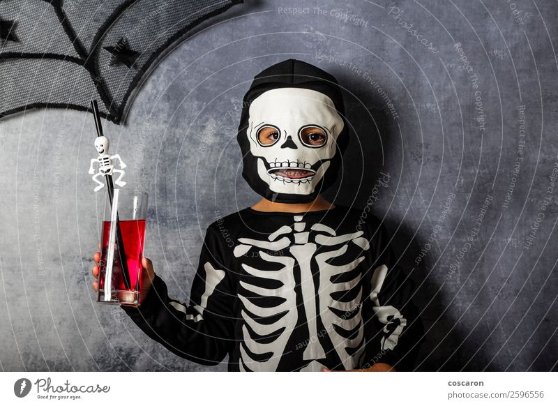 Little kid in a skeleton costume on Halloween Juice Lifestyle Joy Happy Beautiful Face Make-up Leisure and hobbies Entertainment Party Feasts & Celebrations