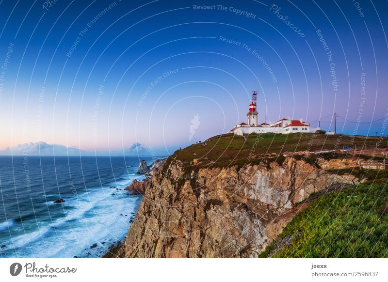 Rocky cliff with lighthouse in almost cloudless evening atmosphere Lighthouse House (Residential Structure) Safety coast steep coast Evening Exterior shot