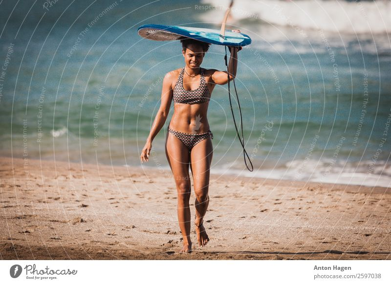Surfer girl carrying blue single fin surfboard from the ocean Lifestyle Vacation & Travel Trip Adventure Freedom Summer vacation Sun Beach Ocean Island Waves