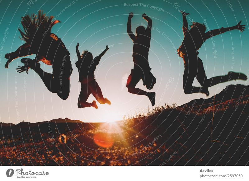 Four people jumping at sunset. Lifestyle Joy Vacation & Travel Trip Summer vacation Sun Hiking Human being Young woman Youth (Young adults) Young man Woman
