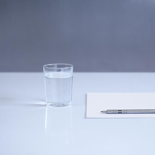 blank Beverage Cold drink Drinking water Glass Stationery Paper Pen Esthetic Simple Modern Blue Gray White Table Colour photo Interior shot Deserted