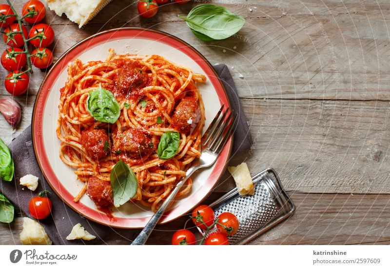 Pasta with tomato sauce and meatballs Meat Cheese Herbs and spices Lunch Dinner Plate Fork Table Fresh Gray Green Red Tradition pasta Basil Spaghetti Tomato