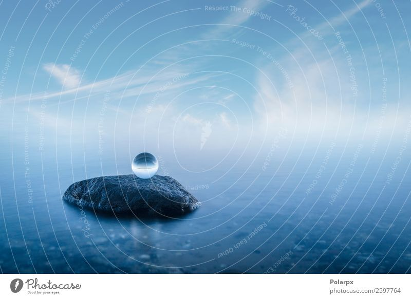 Crystal ball on a rock in a misty seascape Sky Nature Blue Beautiful Landscape Ocean Calm Beach Environment Natural Coast Stone Rock Fog Vantage point