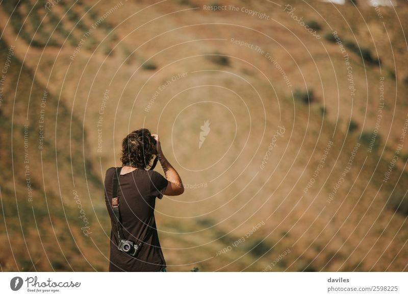 Man photographing nature. Lifestyle Vacation & Travel Adventure Summer Mountain Human being Masculine Young man Youth (Young adults) Adults Back 1 18 - 30 years