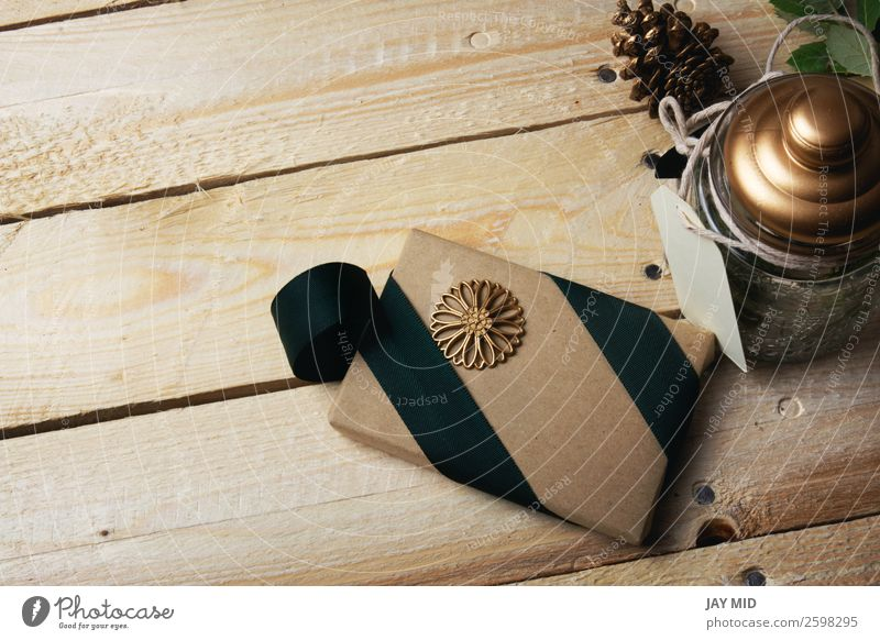 Gift box, wrapped in recycled paper, green bow Roll Elegant Style Handicraft Handcrafts Valentine's Day Mother's Day Thanksgiving Christmas & Advent Paper Wood