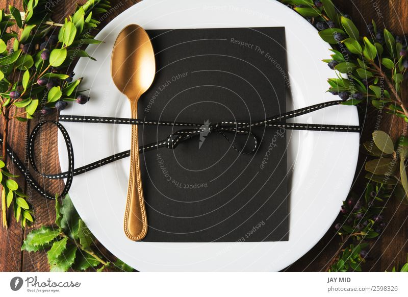 menu place setting with empty card and golden spoon over Old Christmas & Advent Winter Black Warmth Food Wood Family & Relations Style Feasts & Celebrations