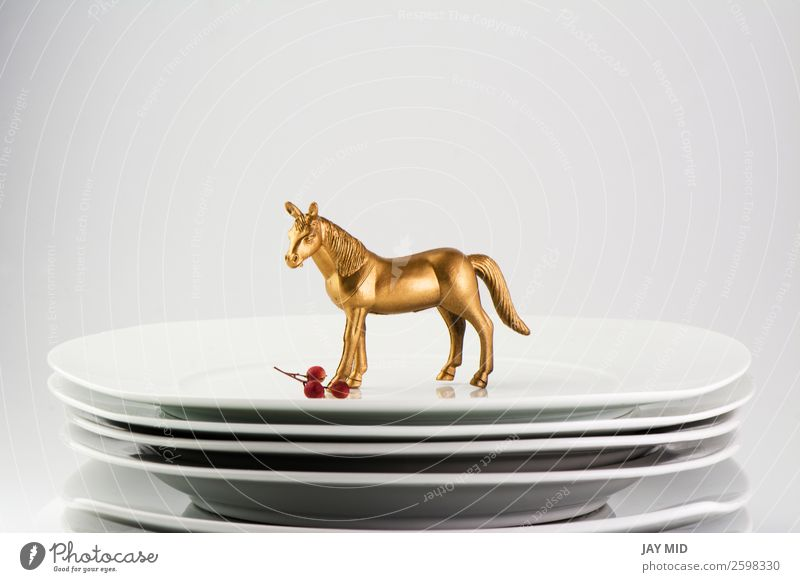 Plates stacked dishes and gold horse. conceptual food holiday Christmas & Advent White Dish Food Feasts & Celebrations Group Glittering Birthday Table Gold