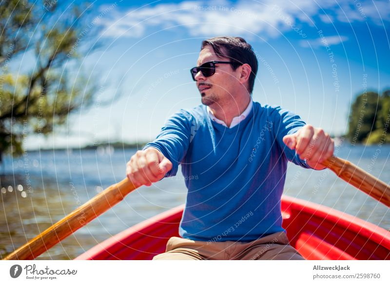Man rowing in a boat on the lake Day Summer Blue sky Beautiful weather Leisure and hobbies Clouds Lake Watercraft Oar Rowing Portrait photograph Young man