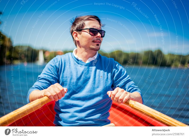 Man rowing in a boat on the lake Day Summer Blue sky Beautiful weather Leisure and hobbies Clouds Water Lake Watercraft Oar Rowing Portrait photograph Young man