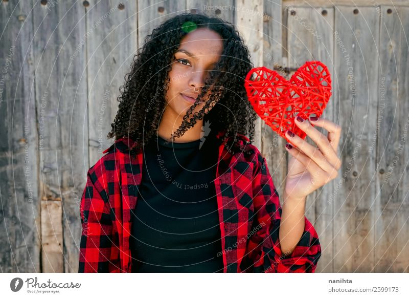 Beautiful young woman holding a red heart Woman Human being Youth (Young adults) Young woman Red Loneliness Joy Black Lifestyle Adults Wood Love Natural