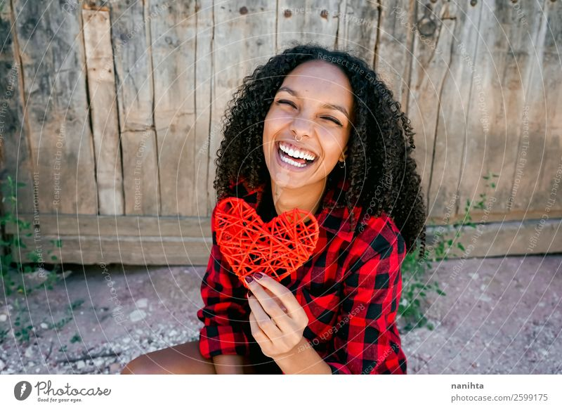 Beautiful young woman holding a red heart Woman Human being Youth (Young adults) Young woman Red Joy Black 18 - 30 years Healthy Lifestyle Adults Love Natural