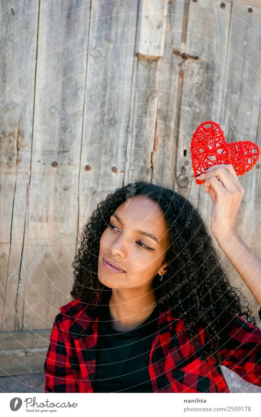 Beautiful young woman holding a red heart Lifestyle Style Joy Hair and hairstyles Human being Young woman Youth (Young adults) Woman Adults 1 18 - 30 years