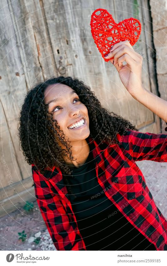 Beautiful young woman holding a red heart Lifestyle Style Joy Hair and hairstyles Human being Feminine Young woman Youth (Young adults) Woman Adults 1