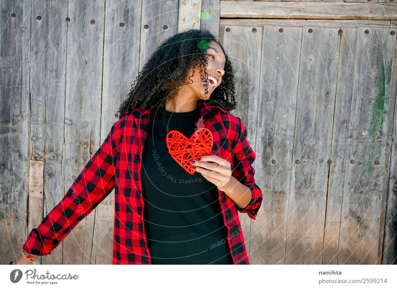 Beautiful young woman holding a red heart Woman Human being Youth (Young adults) Young woman Red Joy Black 18 - 30 years Healthy Lifestyle Adults Wood Love