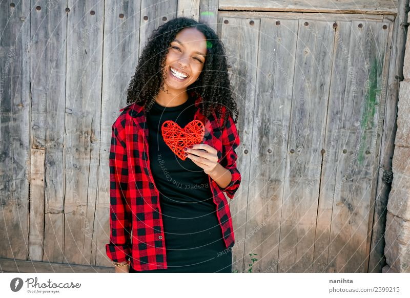 Beautiful young woman holding a red heart Woman Human being Youth (Young adults) Young woman Red Loneliness Joy Black 18 - 30 years Lifestyle Adults Wood Love