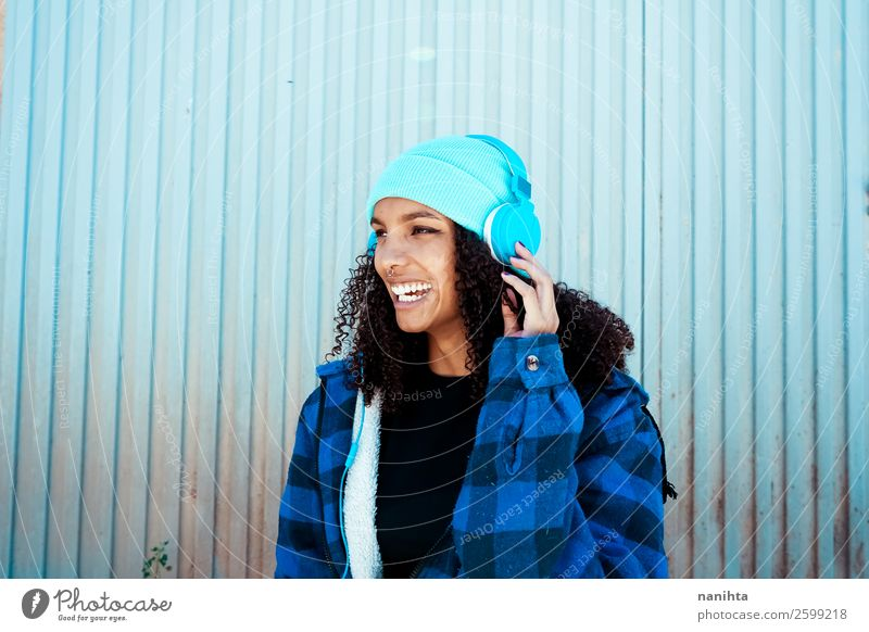 Young woman listening to music Woman Human being Youth (Young adults) Blue Beautiful Winter Black 18 - 30 years Healthy Lifestyle Adults Feminine Emotions