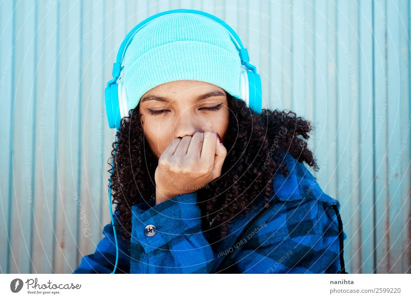 Young teen woman listening to musid Woman Human being Youth (Young adults) Young woman Blue Winter Black 18 - 30 years Lifestyle Adults Feminine Emotions Style