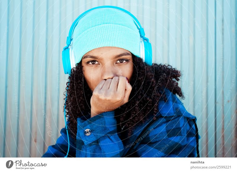 Young teen woman listening to music Woman Human being Youth (Young adults) Young woman Blue Winter Black 18 - 30 years Lifestyle Adults Feminine Emotions Style
