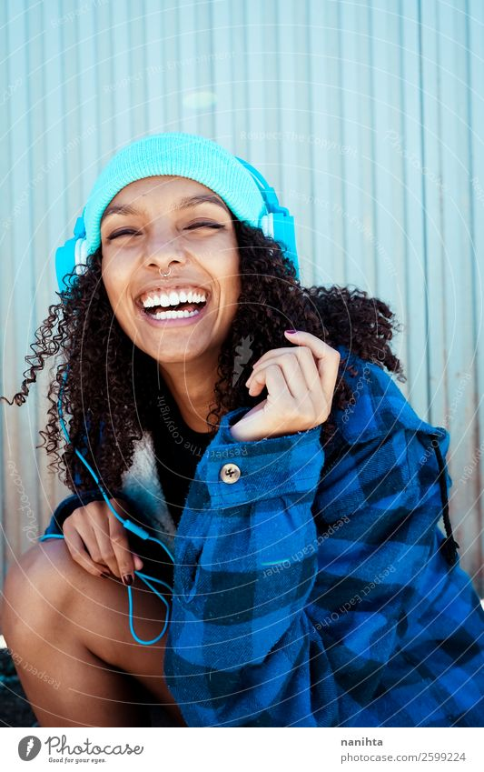 Young teen woman listening to music - a Royalty Free Stock Photo from  Photocase