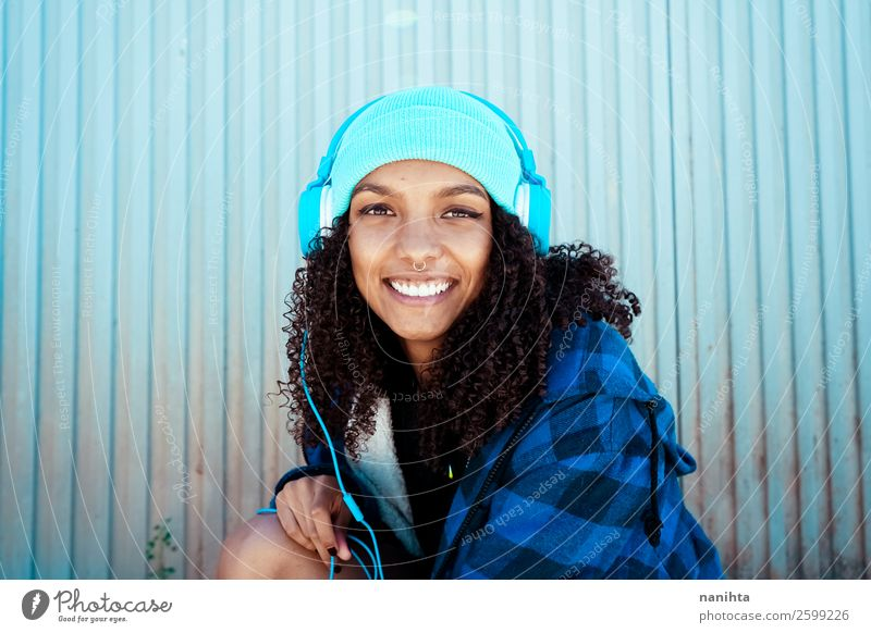 Young woman listening to music Woman Human being Youth (Young adults) Blue Beautiful Winter Black 18 - 30 years Lifestyle Adults Feminine Emotions Style