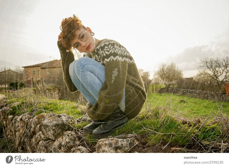 Young woman hugging herself alone in nature Lifestyle Joy Happy Beautiful Hair and hairstyles Senses Relaxation Leisure and hobbies Far-off places Freedom