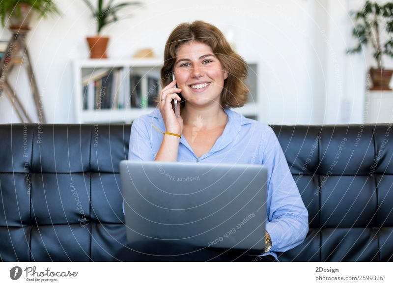Entrepreneur woman wearing blue shirt working with a laptop sitting on a couch at home Shopping Happy Beautiful Sofa School Study Academic studies