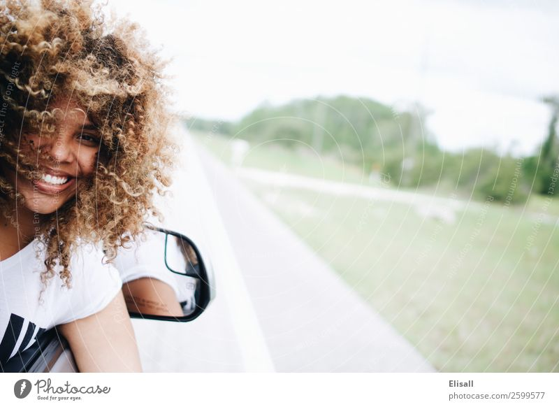 Happy woman traveling in car Human being Vacation & Travel Joy Street Emotions Hair and hairstyles Trip Car Power Smiling Happiness Success