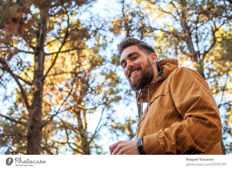 Portrait of a smiling man with autumnal background. Human being Nature Vacation & Travel Youth (Young adults) Blue Beautiful Young man Joy 18 - 30 years Adults