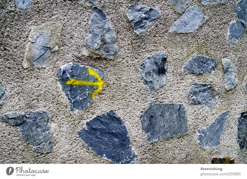 --> this way! Wall (barrier) Wall (building) Stone Concrete Sign Graffiti Arrow Brown Yellow Gray Black Lanes & trails Direction Right Line