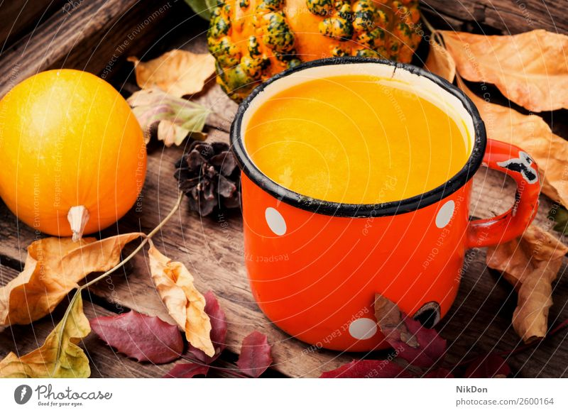 Healthy pumpkin smoothie drink autumn fall food vegetable metal fallen leaves mug beverage healthy orange fresh vegetarian sweet cocktail juice dessert rustic