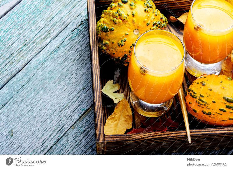 Beverage with pumpkins smoothie drink autumn fall food glass vegetable fallen leaves beverage healthy orange fresh vegetarian copy space cocktail juice dessert
