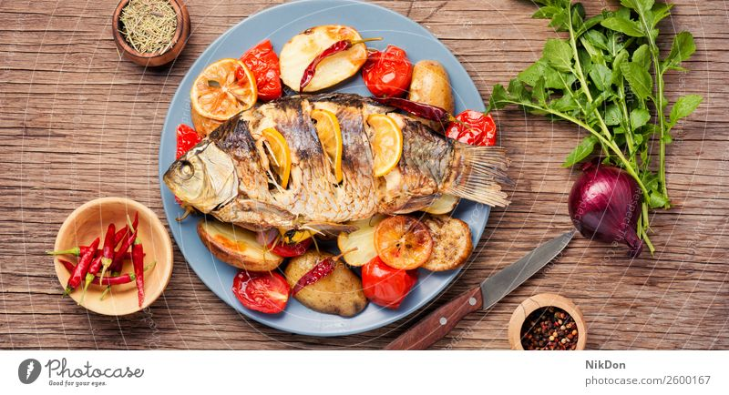 Fish baked with vegetable garnish fish carp meal grilled dinner seafood lemon healthy plate lunch cuisine dish diet roasted parsley flat lay fried paprika