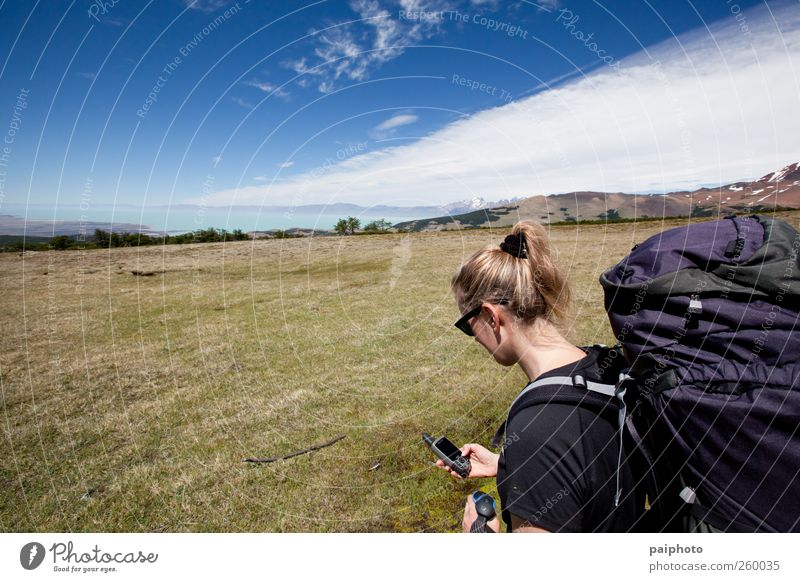 Woman navigating Backpack Blonde Blue Clouds Gps Grass Lake Mountain Navigation Navigation system Savannah Sky Traveling Vacation & Travel White Yellow