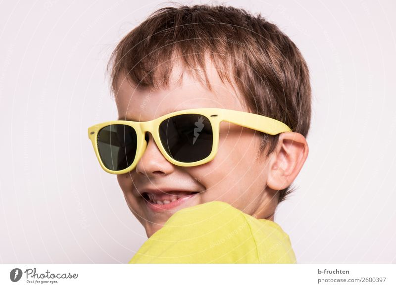 Child with sunglasses Head Face 3 - 8 years Infancy Eyeglasses Sunglasses Observe Smiling Looking Happiness Curiosity Yellow Joy Cool (slang)