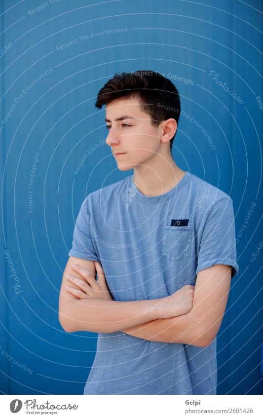 Portrait of a teenager Human being Youth (Young adults) Man Blue Beautiful White Face Lifestyle Adults Sadness Natural Style Boy (child) Fashion Fresh Modern