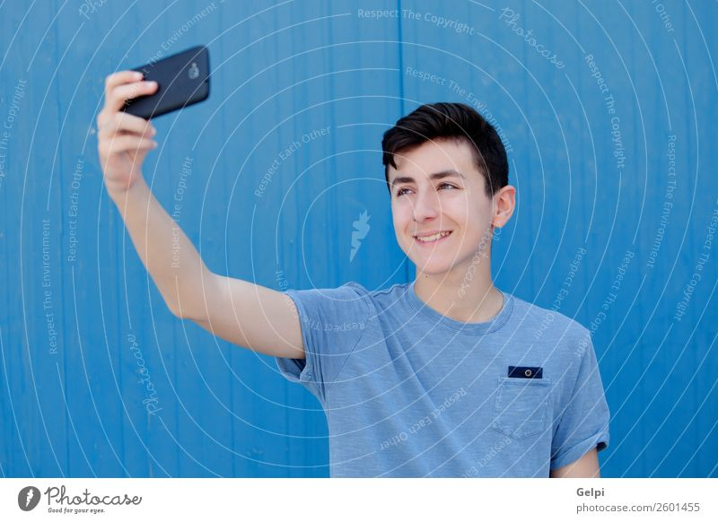Portrait of a teenager Lifestyle Happy Face Playing Music Telephone PDA Technology Human being Boy (child) Man Adults Youth (Young adults) Street Fashion
